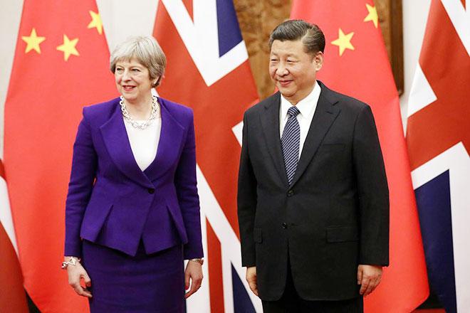Thủ tướng Anh Theresa May và Chủ tịch Trung Quốc Tập Cận Bình. Ảnh Reuters.