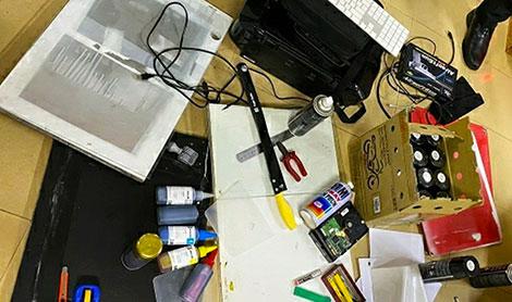 Tang vật các vụ sản xuất, lưu hành tiền giả do cơ quan công an phát hiện.