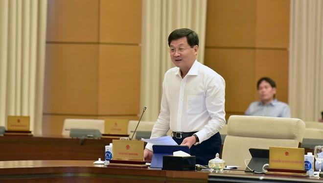 Tổng Thanh tra Chính phủ Lê Minh Khái trình bày Báo cáo của Chính phủ về công tác giải quyết khiếu nại, tố cáo năm 2020.