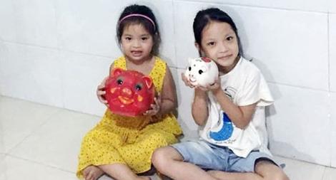 """Hai bé gái ủng hộ 14 triệu đồng từ """"lợn đất"""" để chống dịch"""