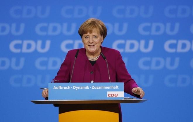 Thắng lợi kép của Thủ tướng Đức Markel